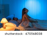 the woman with an insomnia sit... | Shutterstock . vector #670568038