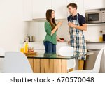 young couple on the kitchen... | Shutterstock . vector #670570048