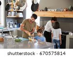 family in kitchen making... | Shutterstock . vector #670575814