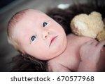 cute newborn baby smiling... | Shutterstock . vector #670577968