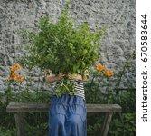 girl with a bouquet of lemon... | Shutterstock . vector #670583644
