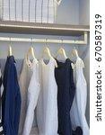 woman blouse on hanger in closet | Shutterstock . vector #670587319