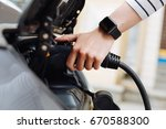 female hands holding charger... | Shutterstock . vector #670588300
