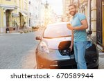 handsome man drinking coffee... | Shutterstock . vector #670589944