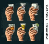 male hand holding a glass with... | Shutterstock .eps vector #670591846