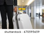 businessman and suitcase in the ... | Shutterstock . vector #670595659