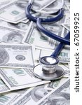 heap of dollars with stethoscope