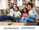 family sitting on sofa in open... | Shutterstock . vector #670599253