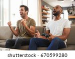 two male friends sitting on... | Shutterstock . vector #670599280