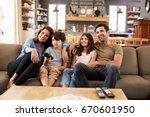 family sitting on sofa in open... | Shutterstock . vector #670601950