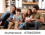 family sitting on sofa in open... | Shutterstock . vector #670602004