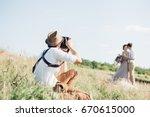 wedding photographer takes... | Shutterstock . vector #670615000