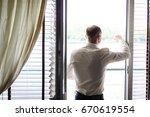 the handsome groom looking at...   Shutterstock . vector #670619554