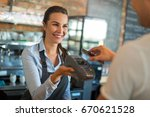 woman working at cafe | Shutterstock . vector #670621528