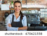 woman working at cafe | Shutterstock . vector #670621558