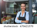 woman working at cafe | Shutterstock . vector #670621570