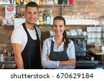 young man and woman working at... | Shutterstock . vector #670629184