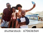 family posing for selfie next... | Shutterstock . vector #670636564