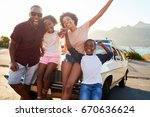 portrait of family standing... | Shutterstock . vector #670636624