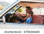 father and son in front seat of ... | Shutterstock . vector #670636660