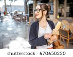 young stylish woman buying a... | Shutterstock . vector #670650220