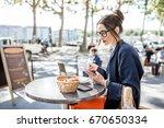 young woman having a breakfast... | Shutterstock . vector #670650334