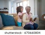 grandmother and granddaughter... | Shutterstock . vector #670660804