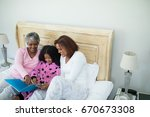 smiling family watching photo... | Shutterstock . vector #670673308