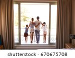 rear view of family on balcony... | Shutterstock . vector #670675708