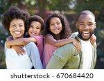 portrait of parents giving... | Shutterstock . vector #670684420