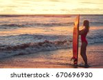 attractive girl with a surf... | Shutterstock . vector #670696930