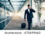 handsome young man on business... | Shutterstock . vector #670699660