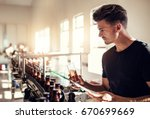 young man examining the quality ... | Shutterstock . vector #670699669