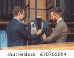 customer and tailor in studio | Shutterstock . vector #670702054