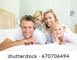 portrait of happy family lying... | Shutterstock . vector #670706494