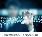businessman holding icons | Shutterstock . vector #670707010