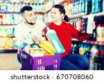 smiling people buying... | Shutterstock . vector #670708060
