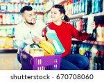 smiling people buying... | Shutterstock . vector #670708060