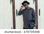 a young african man in... | Shutterstock . vector #670735348