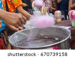 people are making cotton candy... | Shutterstock . vector #670739158