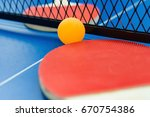 pingpong rackets and ball and... | Shutterstock . vector #670754386