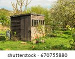 tiny house or shed at a plot of ... | Shutterstock . vector #670755880