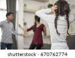 in back view  little girl puts...   Shutterstock . vector #670762774