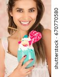 smiling young beautiful woman... | Shutterstock . vector #670770580