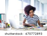 female executive working at her ... | Shutterstock . vector #670772893