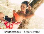 happy traveler woman in bikini... | Shutterstock . vector #670784980