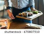 waiters carrying plates with... | Shutterstock . vector #670807510