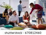 happy executives discussing... | Shutterstock . vector #670812460