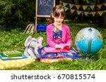 student reading a book. globe.... | Shutterstock . vector #670815574