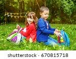 children sit on the grass.... | Shutterstock . vector #670815718